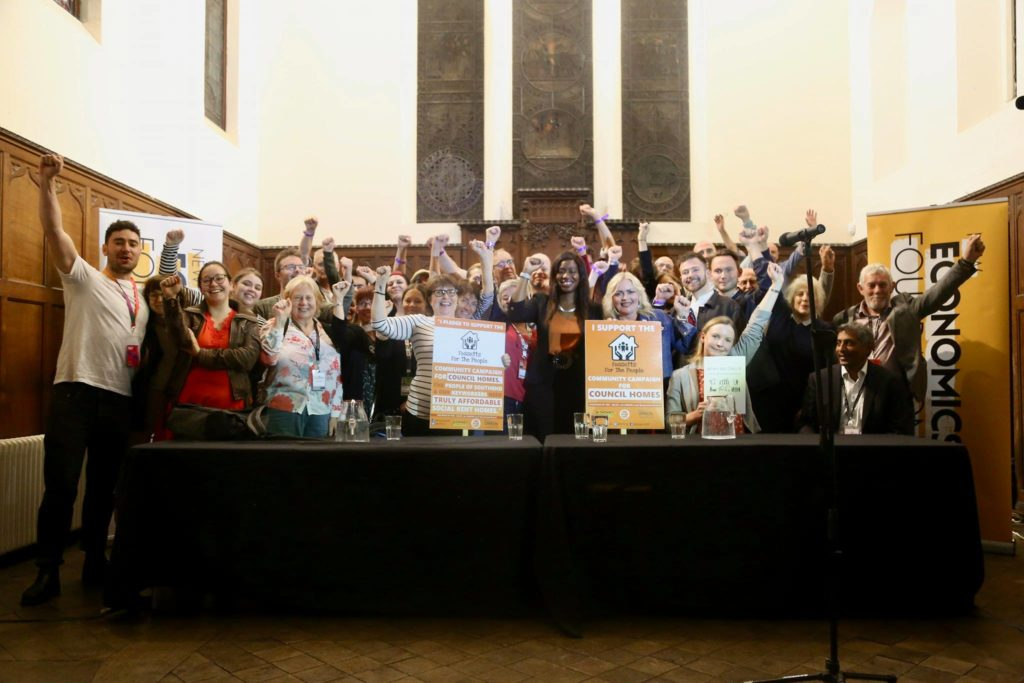 Campaign Co-Chairs Tricia Cowdrey (L) & Kate Sheehan (R) with pledge boards, with campaigners and NEF staff Photo (c) Gaz De Vere